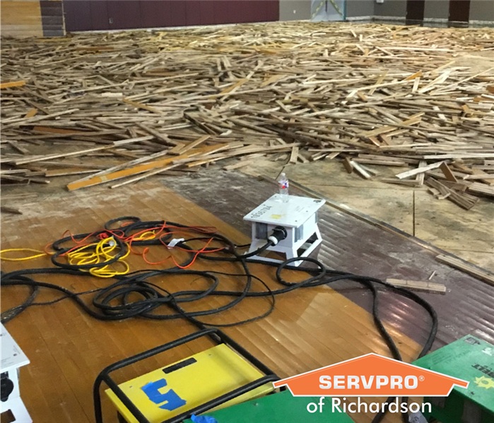 ruined basketball court in school gym after water damage